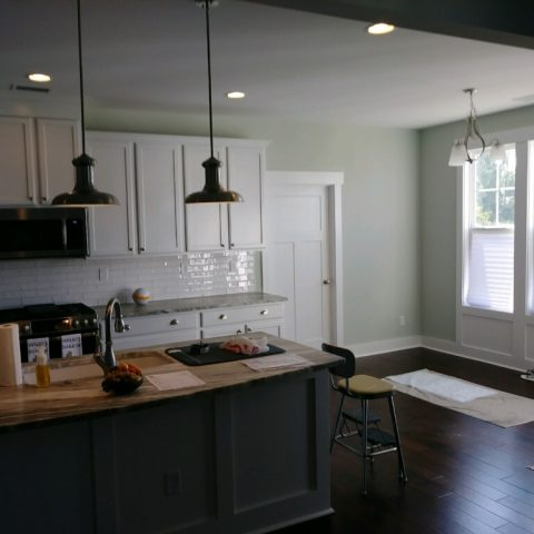 Dark Island and White Kitchen Cabinets