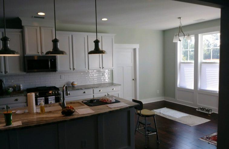 Dark Island and White Kitchen Cabinets
